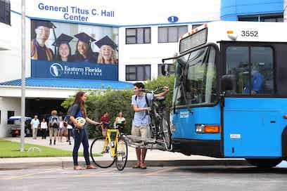 Students loading their bikes on bus