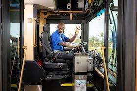 Waving bus driver