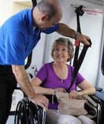 Paratransit Driver helping passenger in wheelchair