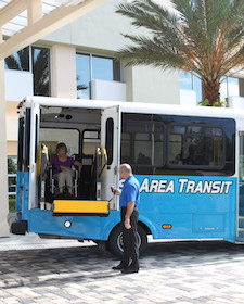 Paratransit driver helping disabled woman